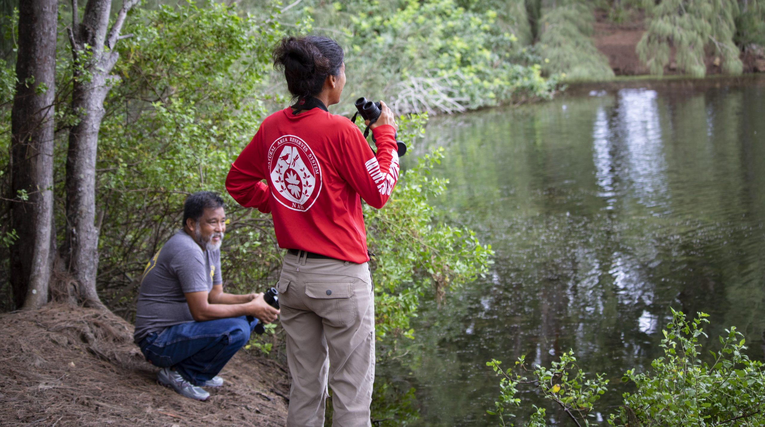 Researchers surveying wetland birds.