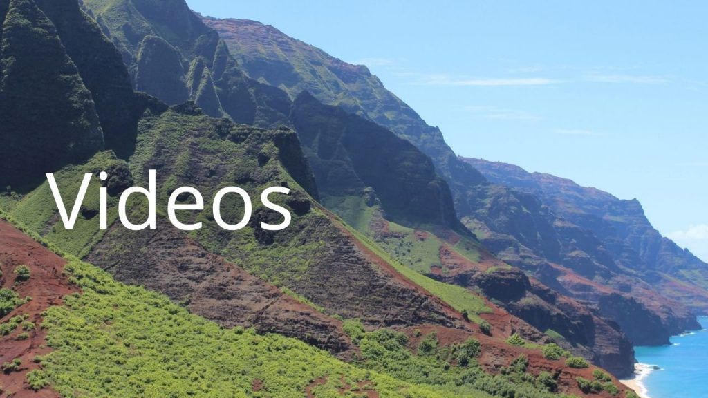 An image of the Na Pali coast with the word Videos
