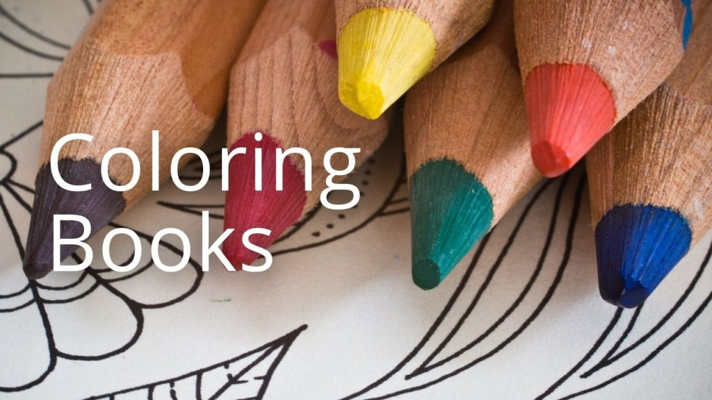 An image of colored pencils with the words Coloring Books