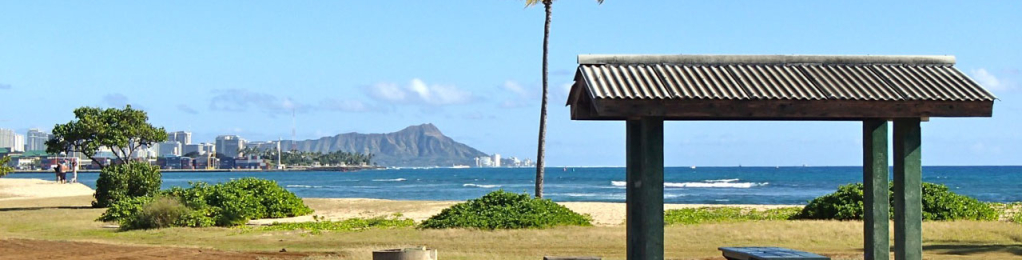 picnic table on beach with view of diamond head
