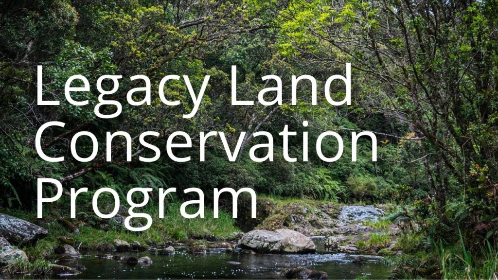 An image of a forest and stream linking to a page called Legacy Land Conservation Program