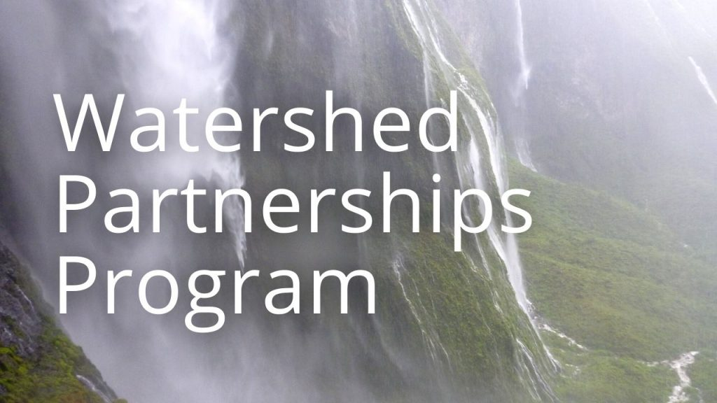An image of a waterfall linking to a page on the watershed partnerships program