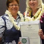 Senator Malama Solomon gives the Community Hero 2013 Award to Mary Begier and the Hawaii Island Chamber of Commerce