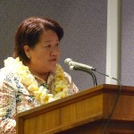 Representative Dee Morikawa gives the Kauai MVP 2013 Award to Craig Kaneshige, HDOA