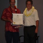 Senator J. Kalani English gives the Maui County MVP 2013 Award to Peter Vorhes, Windward Aviation