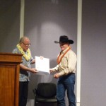 Senator Russell Ruderman gives the Hawaii County MVP 2013 Award to the Hawaii Cattlemen's Council, accepted by Dr. Tim Richards