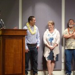 Representatives Tokioka and Kawakami present the Greatest Hit of 2012 Award to the Kauai Invasive Species Committee, accepted by Keren Gundersen and Joe Kona