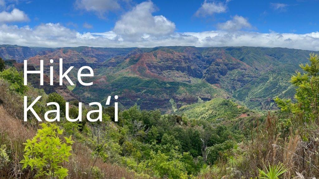 An image of Waimea Canyon with the words Hike Kauaʻi